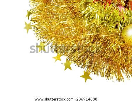 Christmas background. Christmas toys lying on the garland. - stock photo
