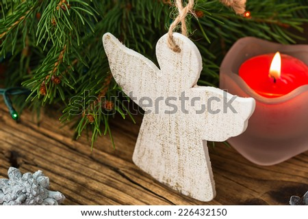 Christmas background. Christmas tree branches with angel on a wooden board - stock photo