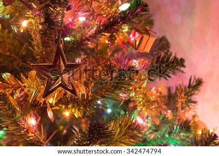 christmas background, christmas tree decorated with twinkling light and christmas ornament in home - stock photo
