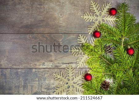 Christmas background, decoration on a rustic wooden board.