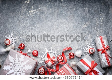 Christmas background festive gift boxes and  presents, paper snowflakes ,red ribbons and decoration, top view - stock photo