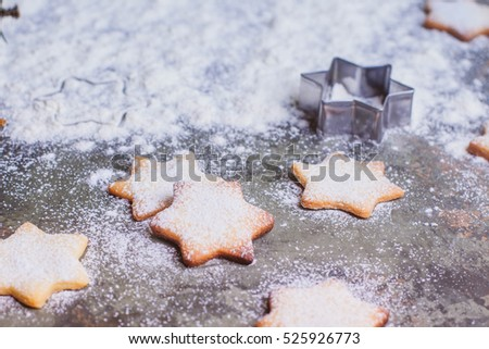 Christmas background - fir tree and holiday cookies star on dark table. Place for text
