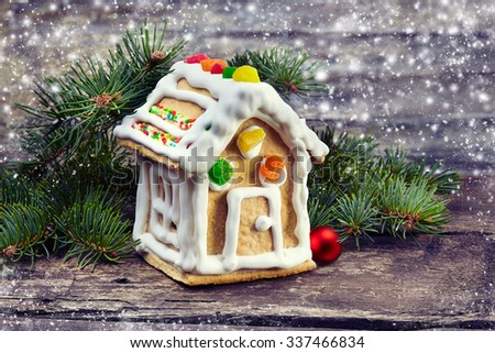 Christmas background.Gingerbread house on wooden background - stock photo