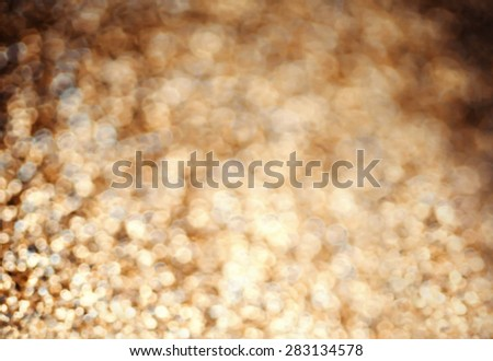 Christmas Background. Golden festive glowing lights Abstract Glitter Defocused Background with blinking light. Holiday blurred bokeh close up. - stock photo