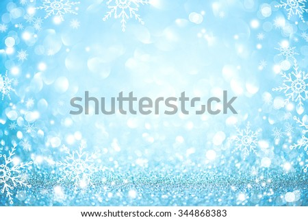 Christmas Background. Golden Holiday glowing Abstract Glitter Defocused Background With Blinking Stars and snowflakes. Blurred Blue color Bokeh
