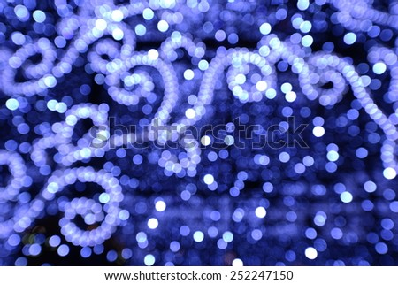 Christmas background. Holiday elegant abstract background with blue bokeh lights and patterns. - stock photo