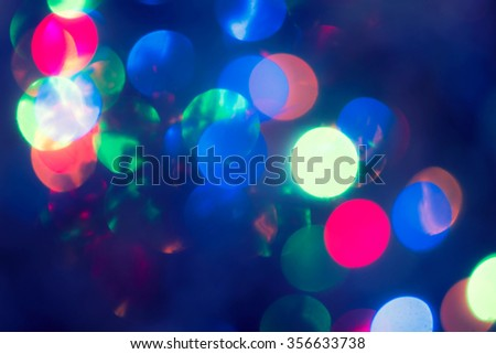 Christmas Background.  Holiday glowing Abstract Defocused Background With Blinking lights. Blurred Bokeh. Retro Color Vintage toned photo with diagonal composition - stock photo