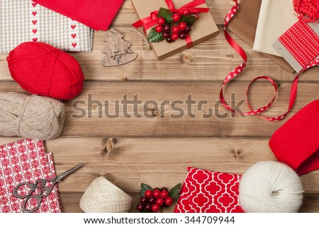 Christmas Background. Knitting And Sewing Kit. Natural Wool Yarn, Linen Textile. Wooden Table With Copy Space. - stock photo