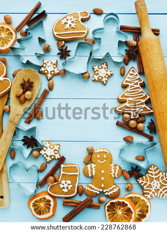 Christmas background made of nuts, dried oranges, and spices. Viewed from above. - stock photo