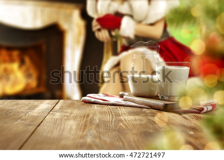 christmas background of milk glasses and fireplace with free space for your decoration