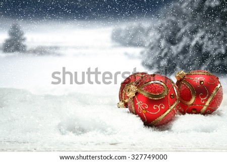 christmas background of snow ice and frost with landscape of park and three red balls  - stock photo