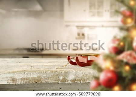 christmas background of wooden table in kitchen and xmas tree