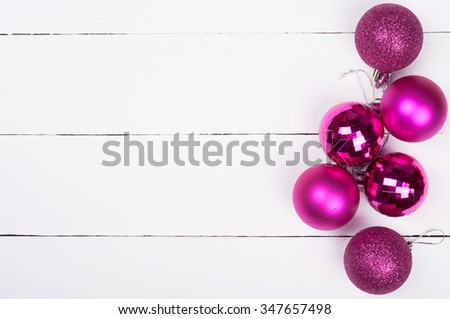 Christmas background. Pink Christmas ornaments on a white wooden background. Lot of copyspace - stock photo