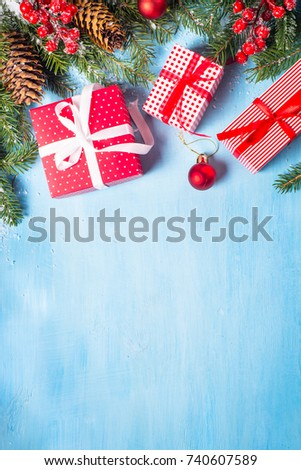 Christmas Background Red Present Box Fir Tree Branch And Decorations On Blue