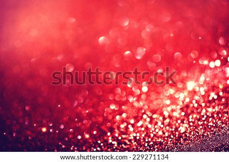 Christmas Background. Red Holiday glowing Abstract Glitter Defocused Background With Blinking Stars. Blurred Bokeh  - stock photo