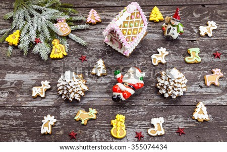 Christmas background. Santa Claus and gingerbreads on dark rustic table, top view - stock photo