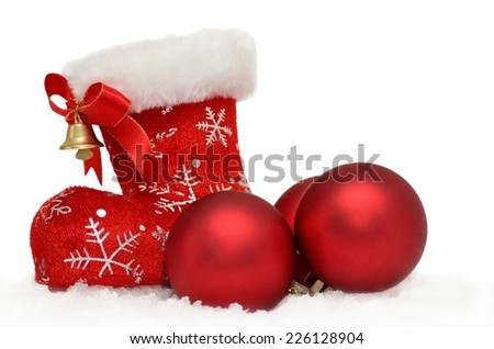 Christmas background Santa's red boot with baubles in snow on white - stock photo