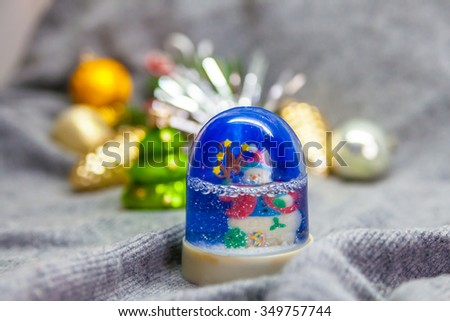 Christmas background: snowman in the blue Snow globe  - stock photo