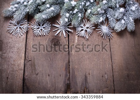 Christmas background. Spruce branches, christmas decorations  on vintage wooden  background.  Selective focus. Place for text.