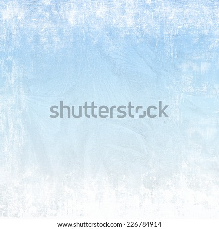 Christmas background - View of the city lights through the frozen window glass - stock photo