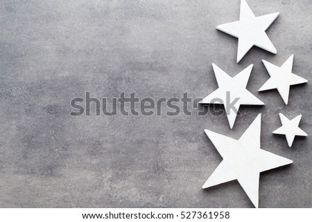 Christmas background. White tree decorations on a gray background. Deer. Spruce. Star. Angel.