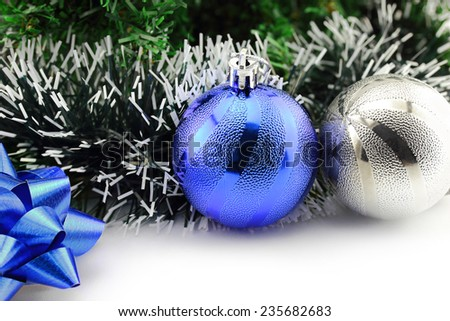 Christmas background with a blue ornament and decorations