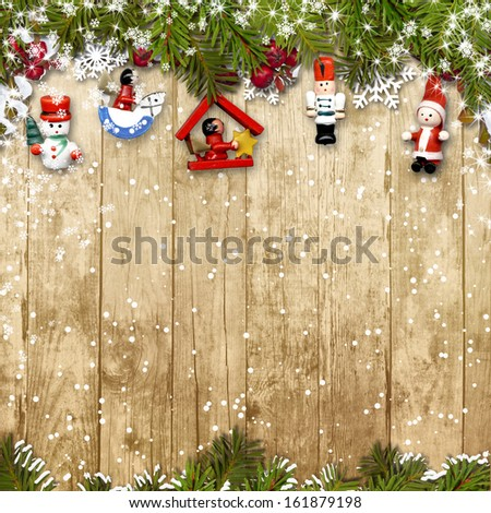 Christmas background with a border of fir branches&decorations - stock photo