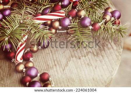 Christmas background with a Christmas decoration, fir branches with blank paper on wooden planks, wooden table background, New year theme