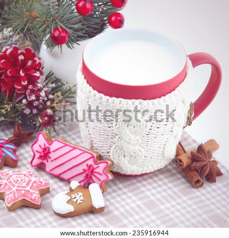 Christmas background with a glass of milk and gingerbread - stock photo