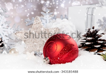 Christmas background with a ornament on snow, Holiday decoration - stock photo