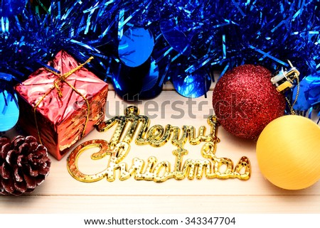 Christmas background with a red and yellow ornament, red gift box,