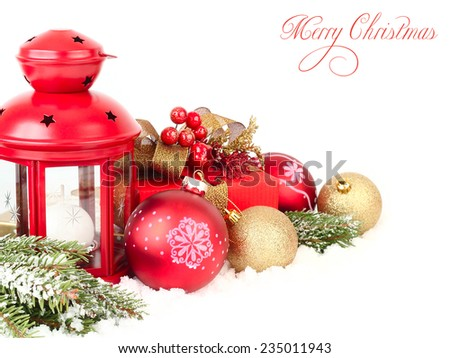 Christmas background with a red lamp, branches of a Christmas tree and Christmas balls.