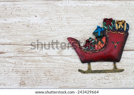 Christmas Background with a Santa Sleigh on Grunge Textured Wood Background  with copy space - stock photo
