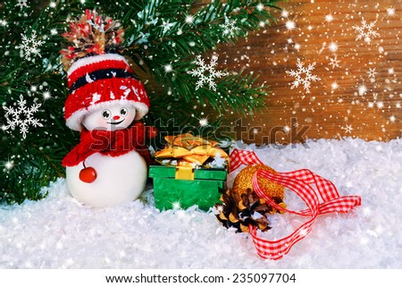 Christmas background with a small snowman on the background of the Christmas tree - stock photo