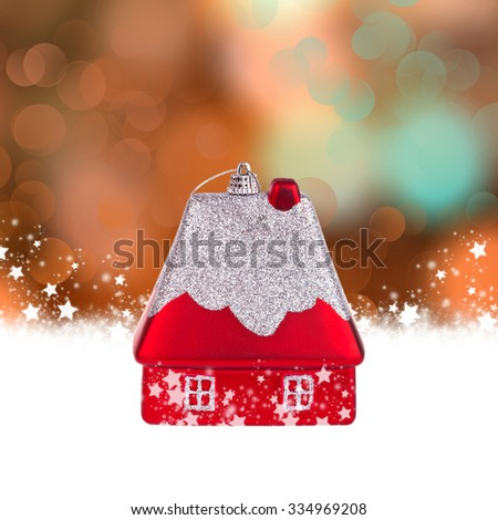 Christmas background with a toy in the form of a house and bokeh lights - stock photo