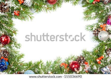 Christmas background with balls and decorations and snow, holly berry, cones isolated on white - stock photo
