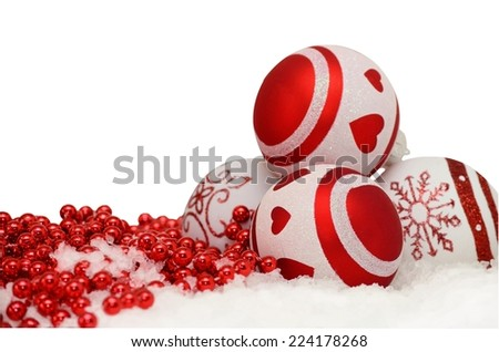 christmas background with balls and red garland in snow on white - stock photo