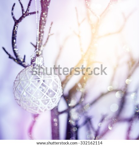 Christmas Background with Bauble on Silver Branch. Shallow Depth of Field, Selective Focus. Bokeh Lights. Festive Mood. - stock photo