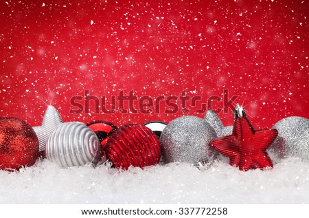 Christmas background with baubles in snow and copy space - stock photo