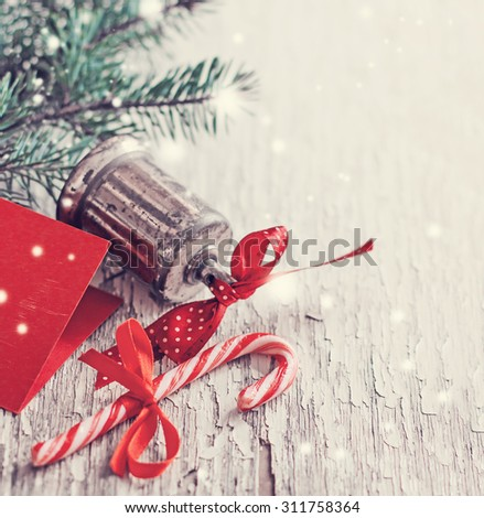Christmas  background with bell and fir brunches - stock photo