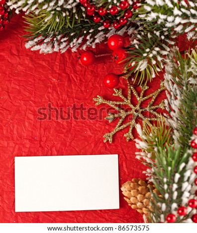Christmas background with blank card and decorations. Copyspace for your text