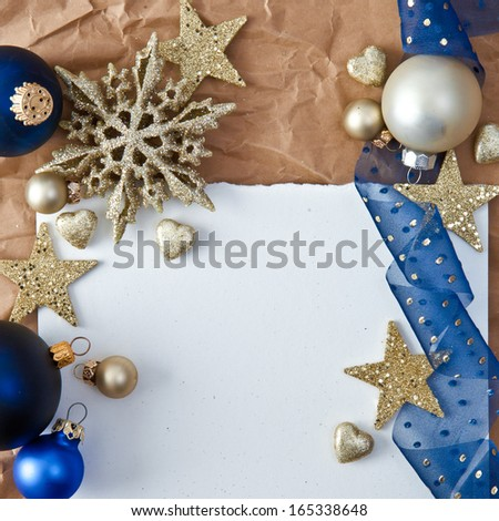 Christmas background with blue baubles and glittery ornaments