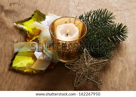Christmas background with candle, baubles, pine branches.  - stock photo