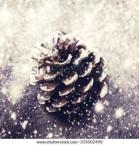 Christmas background with christmas decoration. Festive pine cones with falling snow flakes. Card or invitation. - stock photo