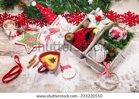 Christmas background with Christmas decoration. Wooden box filled with  ribbons and Christmas tags, on an old wooden table with spicy Christmas cider . Christmas preparation - stock photo