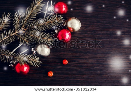 Christmas background with Christmas fir tree and decoration on wooden board. Winter holidays. Xmas theme. Happy New Year. Blurred background. - stock photo