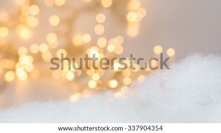 Christmas background with Christmas lightening un focused in the background - stock photo