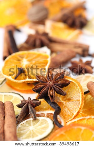 Christmas background with Christmas spices and dried orange slices - stock photo