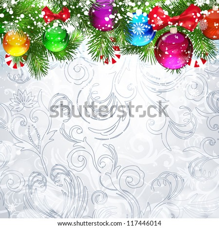 Christmas background with Christmas tree branches decorated with glass balls. - stock photo