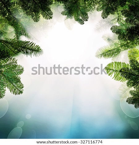 Christmas Background with Christmas Tree Twig. Abstract Fantasy Border with Light and Sparkle for Xmas Card - stock photo
